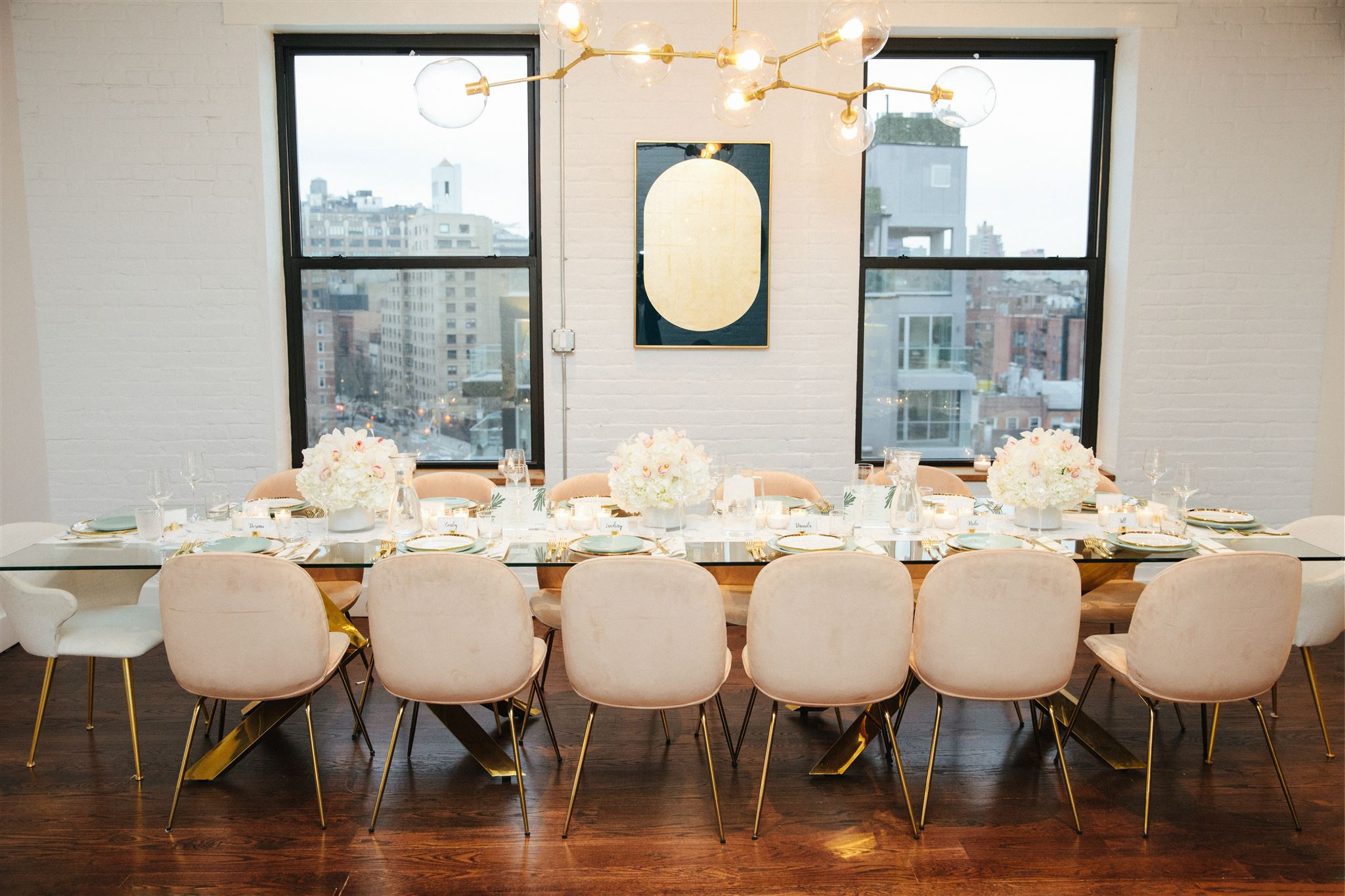 Beautiful, elegant tablescape set for fourteen guests.