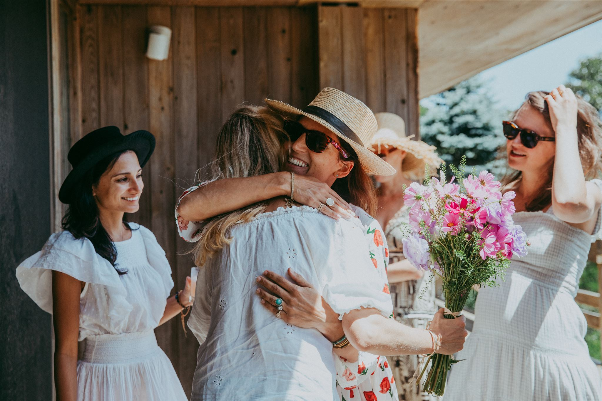 Guests greeting each other in the Hamptons