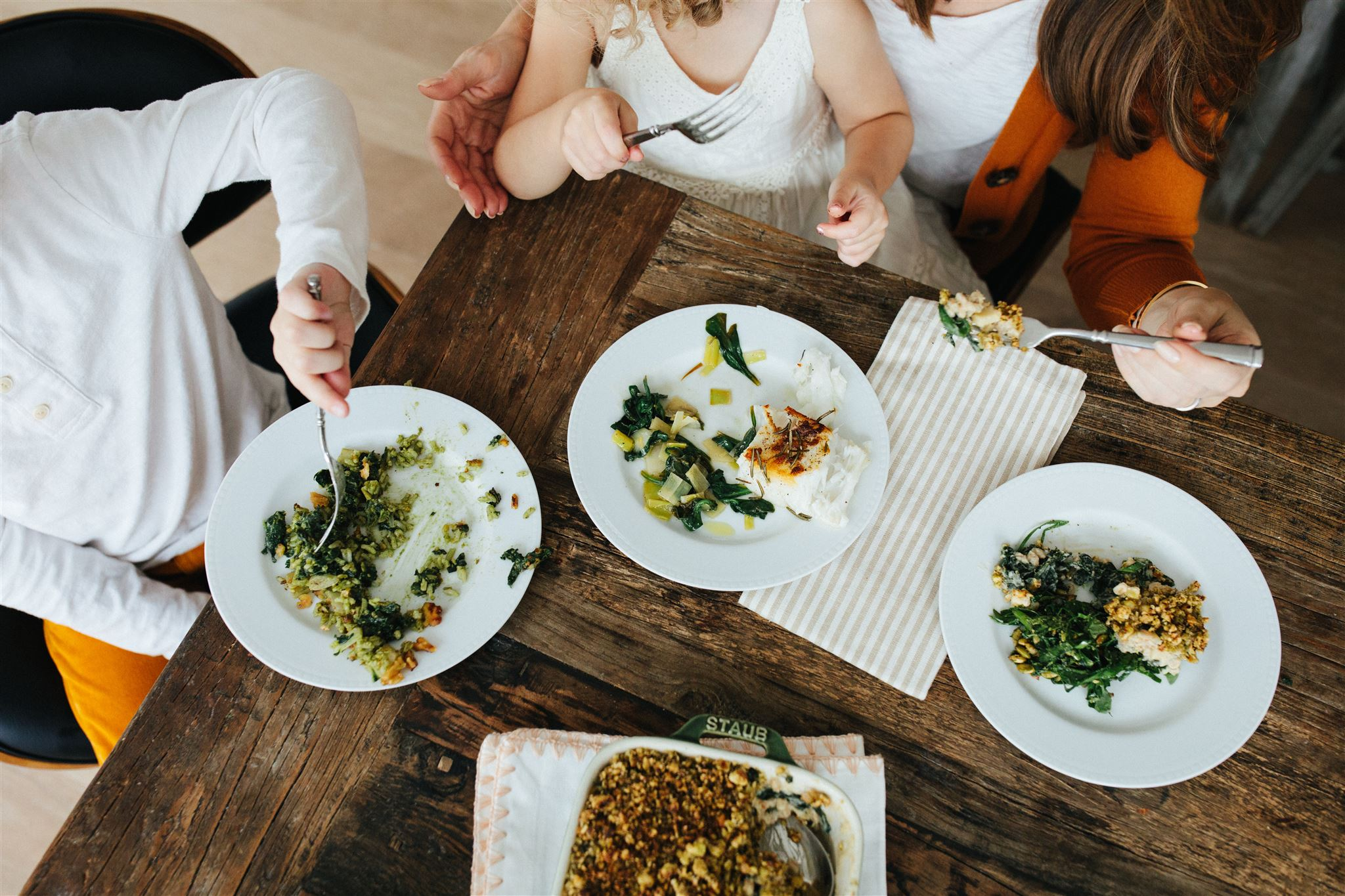 A mother and her two young children enjoying a balanced meal prepared by a Culinista private chef.