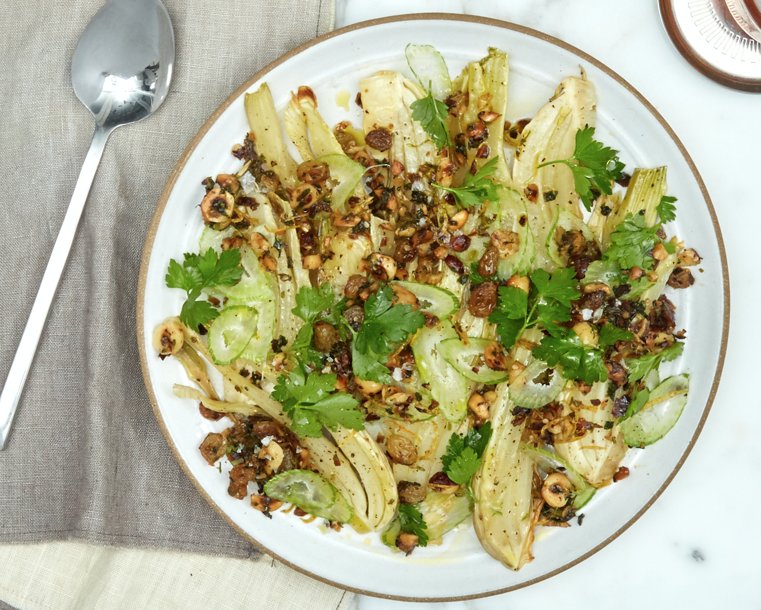 Fennel with a nut and raisin slaw on a plate